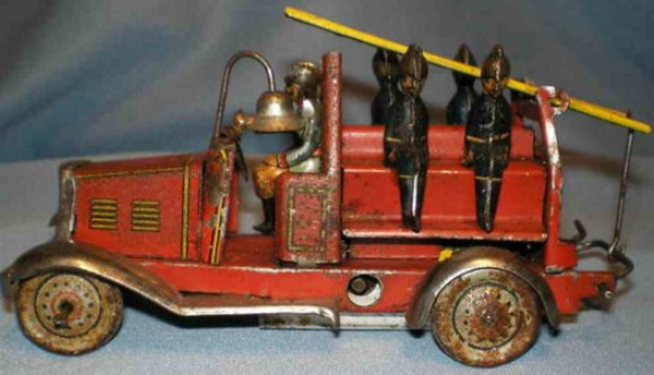 Fischer Georg Tin-Penny Toy Windup tin litho penny toy fire ladder truck. There is a han