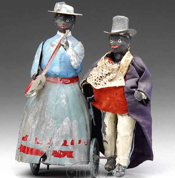 Unknown Tin-Figures Black minstrel clockwork toy hand-painted featuring a black