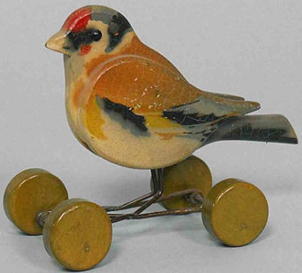 Steiff Wood-Animals A wooden finch 1812ex on excentric wheels from 1919 -1942.