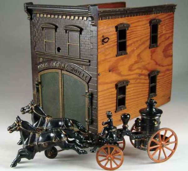 Ives Cast-Iron-Carriages Fire house with pumper wagon, A large firehouse with wood si