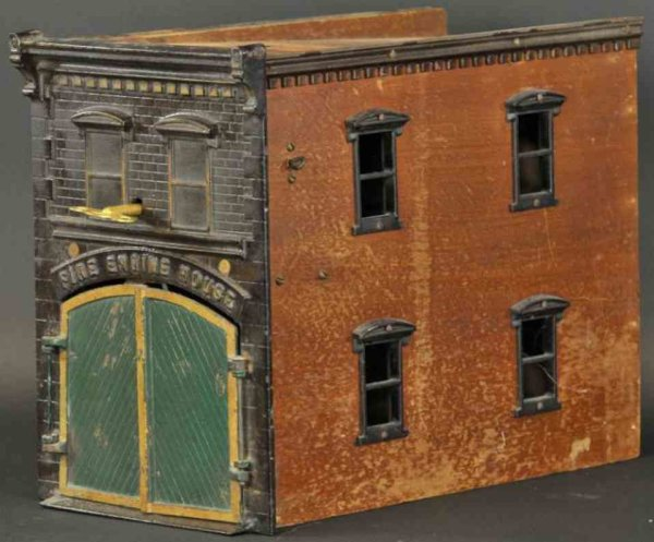 Ives Cast-Iron-Buildings Clockwork fire engine house, well scaled with exceptional de