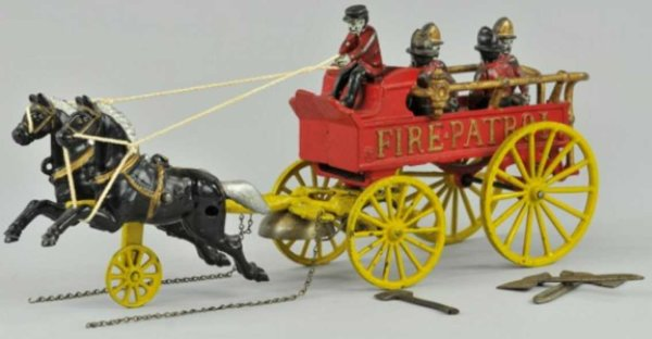 Kenton Hardware Co Cast-Iron-Carriages Horse drawn fire patrol of cast iron, painted in red, emboss