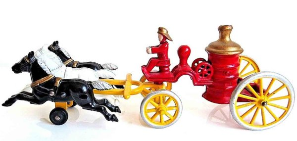 Kenton Hardware Co Cast-Iron-Carriages Cast iron horse drawn fire pumper toy, pulled by three horse