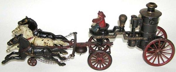 Dent Hardware Co Cast-Iron-Carriages 3-horse fire pumper with driver of cast iron, each horse is