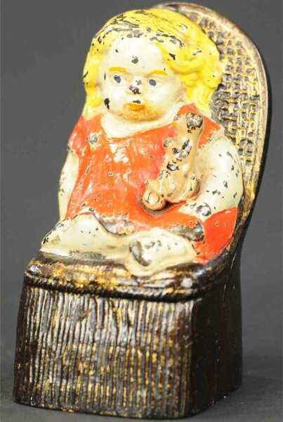 Reed Toy Co. Cast-Iron-Mechanical Banks Girl in Victorian chair mechanical bank, this example featur
