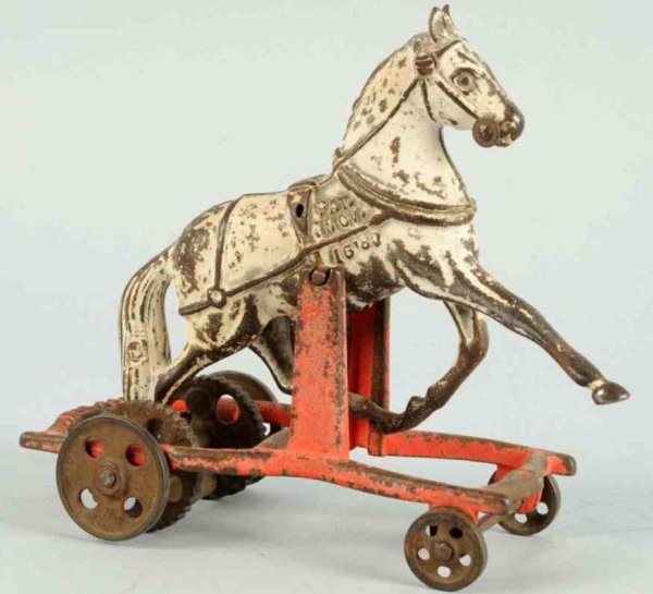 Carpenter Cast-Iron Figures Cast iron white horse on wheels