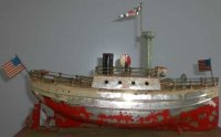 Carette Tin-Ships Warship wind-up toy with flags. The...