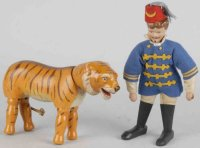 Schoenhut Wood-Figures Lion tamer and painted-eye tiger,...