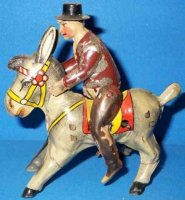 GAMA Tin-Figures Hand-coated rider onto donkey with...