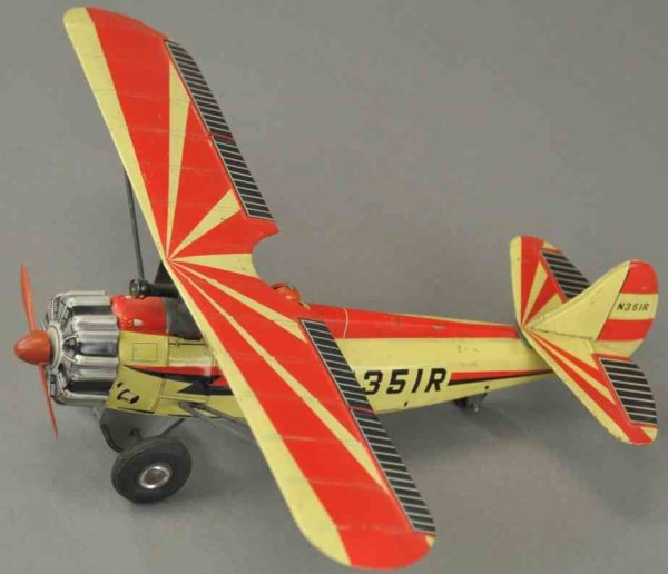 Suzuki & Edwards Tine Ariplanes Fighter plane made of lithographed tin, depicts seated pilot