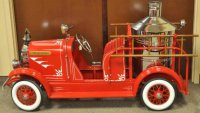 American National Co. Tin-pedal cars Fire pumper, one in...