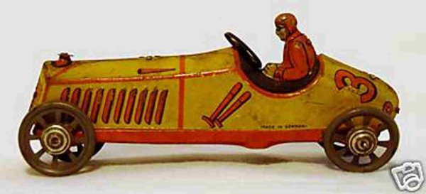 Distler Tin-Penny Toy Race car #616 showing a boat tail or cigar shaped race car.