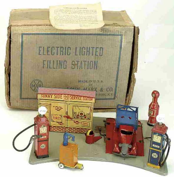 Marx Tin-Toys Service station with auto, battery operated gas globe tanks,