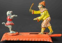 Meier Tin-Penny Toy Clown with dog on red platform....