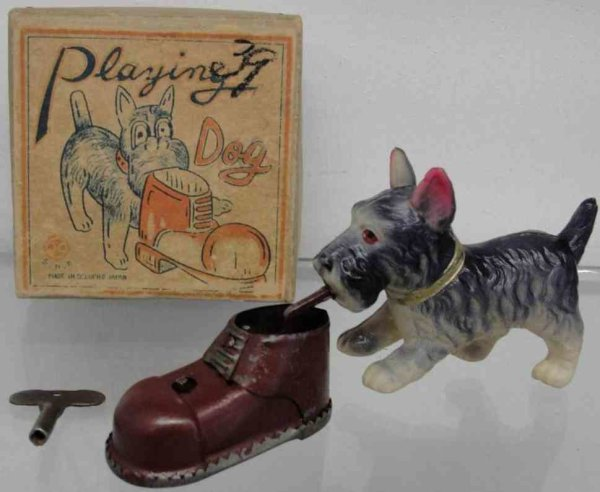 SNK Sankei Tin-Figures Dog with shoe made of tin with windup mechanism, teerrier wi