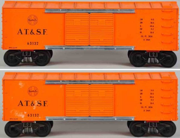 Smith-Miller Tin-Toys Train car made of pressed steel in orange on black rubber wh
