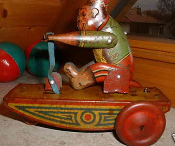 Burnett Ltd Tin-Figures Monkey on a tricycle with elevator mechanism, wound up the m