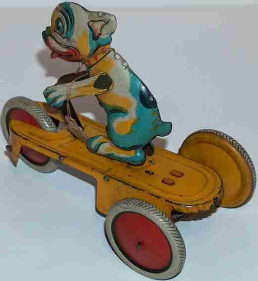 Bell Italy Tin-Figures wind-up tricycle, dog legs marked with Made In Italy & Be