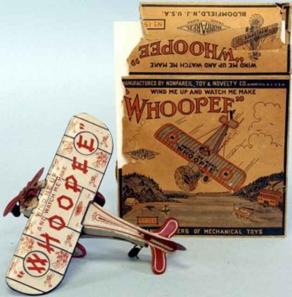 Nonpareil Toy & Novelty Co Tine Ariplanes Whoopee plane, grey airplane with red & blue accents, tin