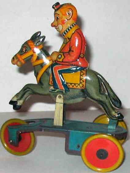 Bell Italy Tin-Clowns Clown on horse, wind-up toy