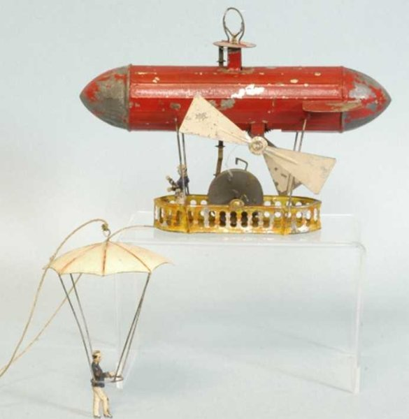 Mueller & Kadeder Tin-Ships toy depicting a parachutist able to land on ground from Diri