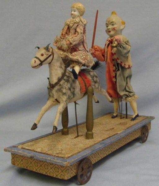Zinner & Sohn Tin-Clowns Pull-toy. Clown riding-teacher with hand-inked ?H 591? under