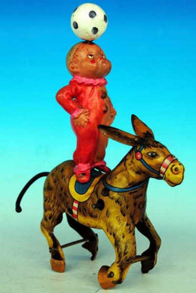 Bandai Tin-Figures Celluloid clown onto sheet donkey with replaced ball