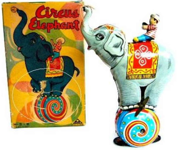 Mitsuhashi Tin-Figures Circus elephant with rider balancing on spinning ball with f
