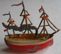 Uebelacker Tin-Penny Toy Boat hand painted and zinc...