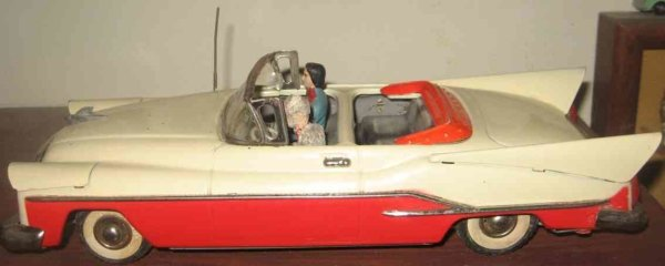 Guenthermann Tin-Cars Chrysler convertible tin friction car in red and beige, with