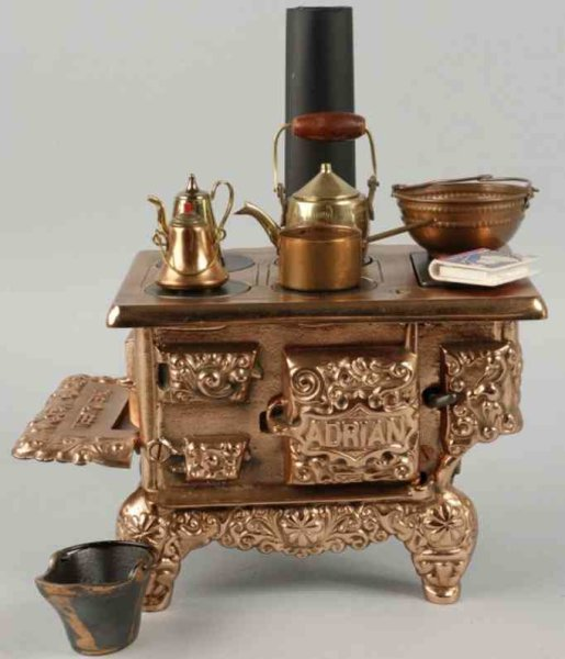 Dent Hardware Co Dolls_Accessories Adrian childrens stove of cast iron with copper finish, inc