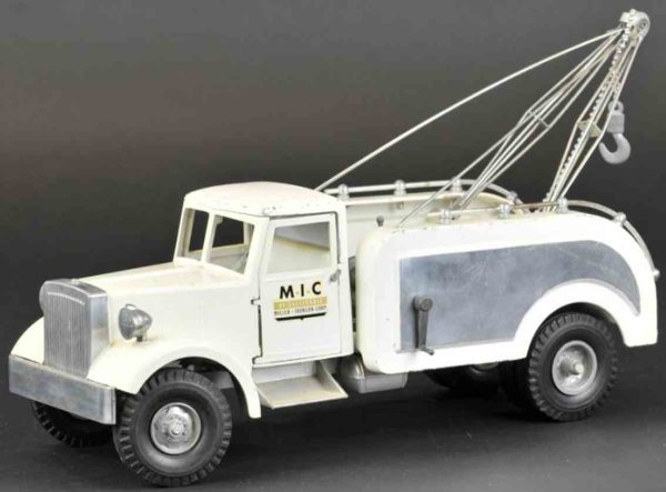 Miller Ironson Corp Cast-Iron trucks Wrecker, die-cast cab with open service bed containing tow b
