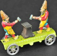 Meier Tin-Penny Toy Gnomes hitting anvil,  lithographed...