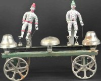 Watrous Mfg. Co. Cast-Iron Figures Two clowns as bell...