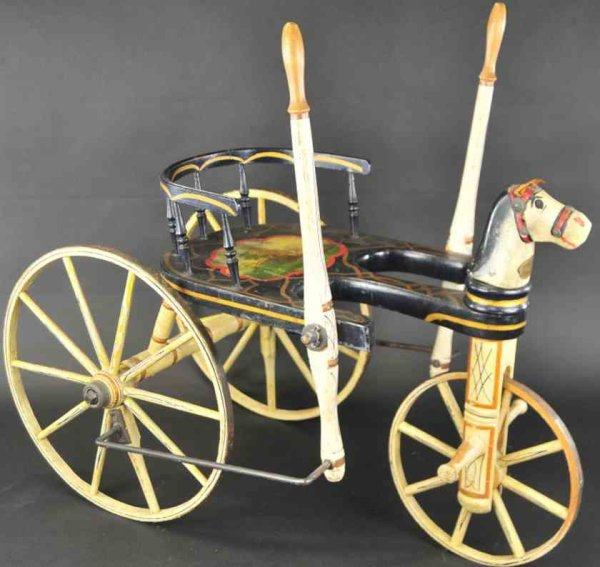 Christian A. Wood-Toys Amercian painted velcipede, exceptional three wheel painted