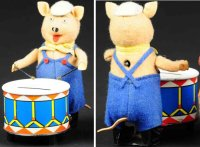 Schuco Tin-Mechanical Banks Pig with drum as mechanical...