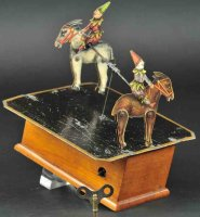 Ives Tin-Clowns Mechanical revolving mule dancers, patent...