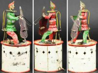 Unknown Tin-Mechanical Banks Clown musician as mechanical...
