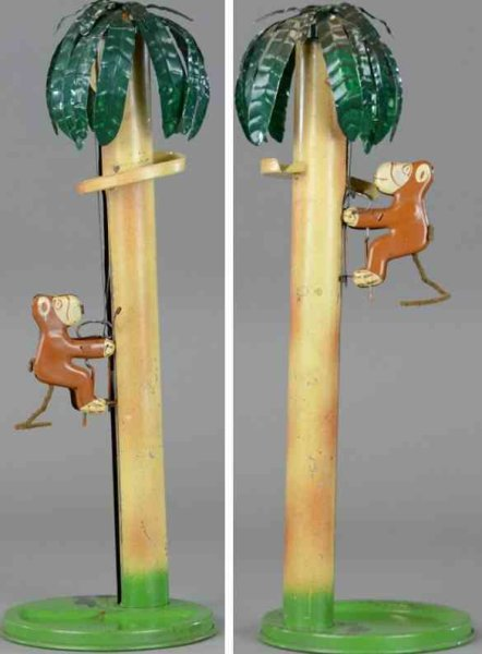 Emporium Specialty Co. Tin-Figures Monkey climbing palm, lithographed tin gravity toy, depicts