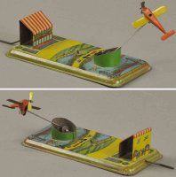 Kellermann Tin-Penny Toy Airplane at airfield, made in...