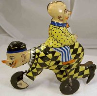 Guenthermann Tin-Clowns Crawling mutt with baby Cicero,...