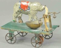 Fallows Tin-Animals Elephant on platform, tin bell toy...