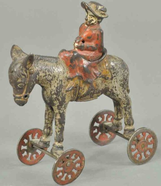 U.S. Hardware Co. Cast-Iron Figures Girl on horse, cast iron, hand painted, articulated axle pos