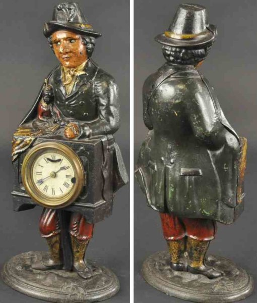 Bradley & Hubbard Cast-Iron Figures Organ grinder cast iron with blinking eye and mechanical clo