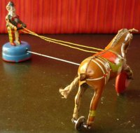 GAMA Tin-Clowns Circus clown with performing  horse, made...