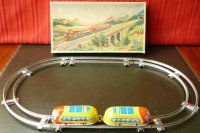 Hoefler J H Tin-Toys Tin wind-up space double train track...