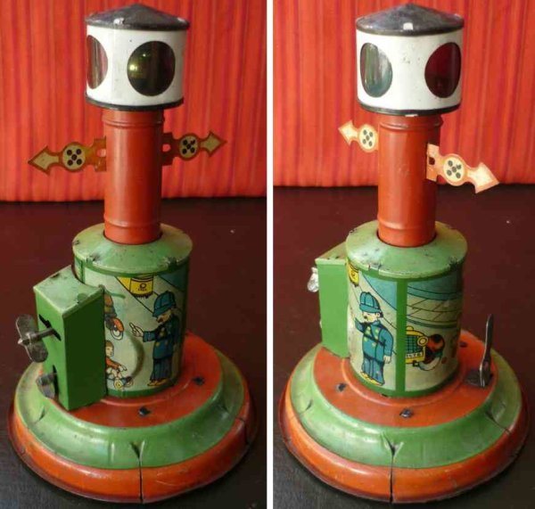 Distler Tin-Toys Tin wind-up traffic signal with electric lighting, works wit