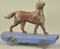 Fallows Tin-Animals Articulated dog on platform, hand...