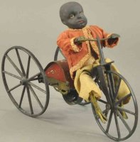 Stevens & Brown Tin-Figures Black boy on velocipede,...