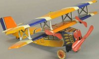 Distler Tine Ariplanes Bi-wing clockwork airplane,...